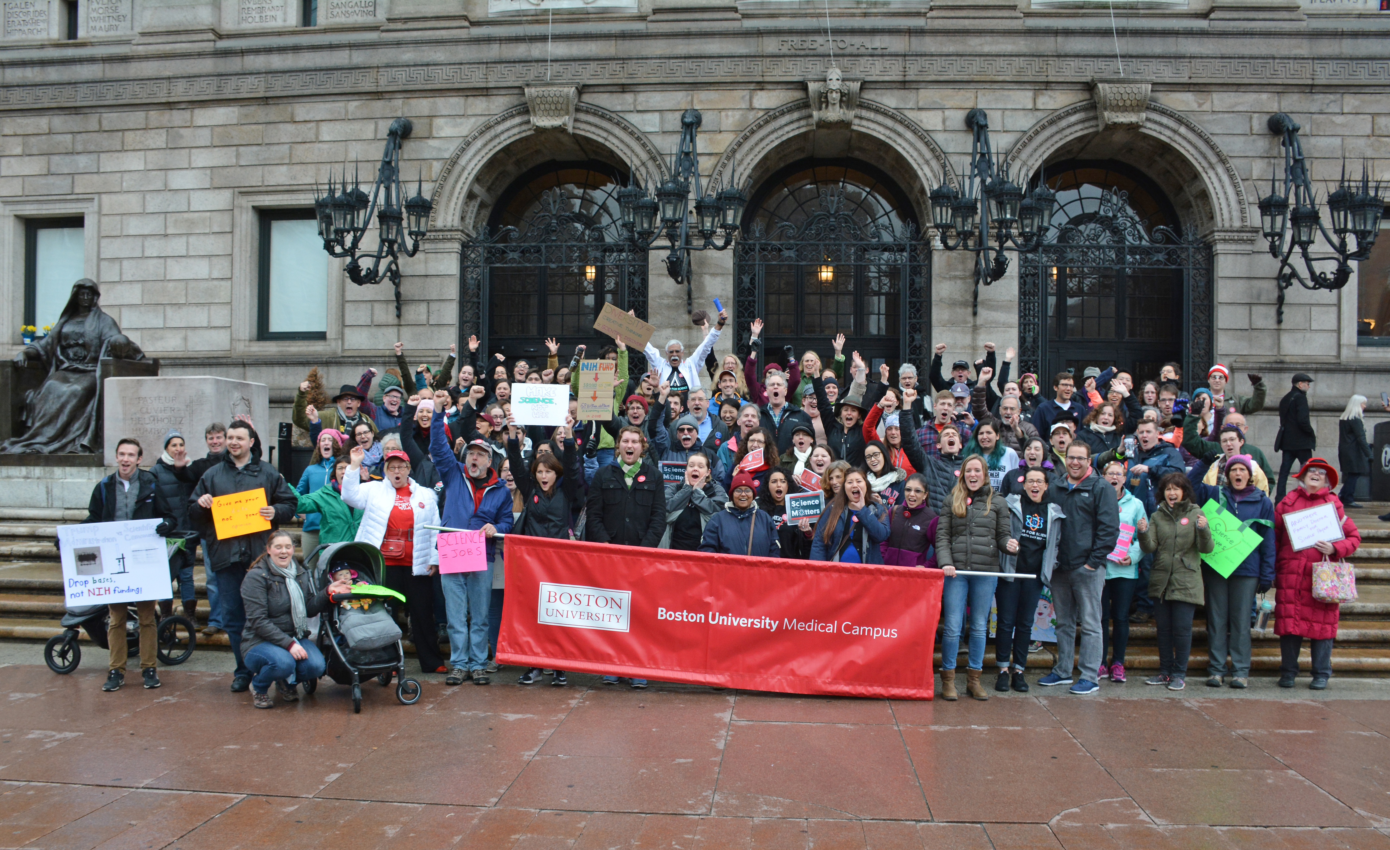 Faculty, staff and students gather at the steps of the Boston Public Library before marching to Boston Common.