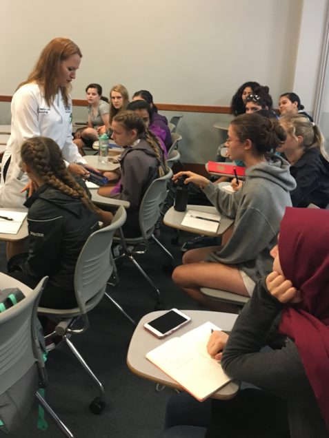 Associate Professor of Neurology Anna Hohler, MD, meets with Summer Pathways students explain how neurologists use Deep Brain Stimulation (DBS) to control symptoms of Parkinsons Disease