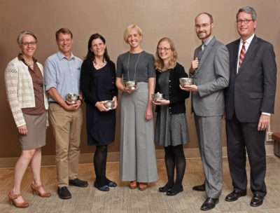 BUMG Education Committee Chair Tracey Dechert, MD with award recipients Drs. James Maypole, Sarah Crane, Shannon Bell, Genevieve Preer, and James Hudspeth, MD, and BUMG CEO William Creevy, MD.