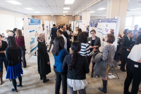 The Health Equity Symposium poster session offered research on topics from refugee women's health to language barriers to disparities in health screenings. Photo by Cydney Scott
