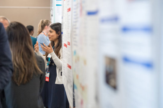 Researchers discussing work at the Health Equity Symposium poster session. Photo by Cydney Scott
