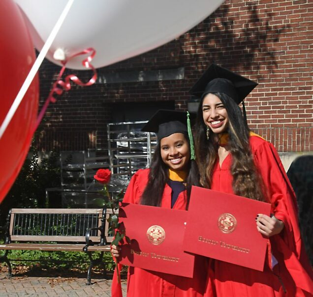 Erica Camacho and Laila Khatib in front of Instructional building.