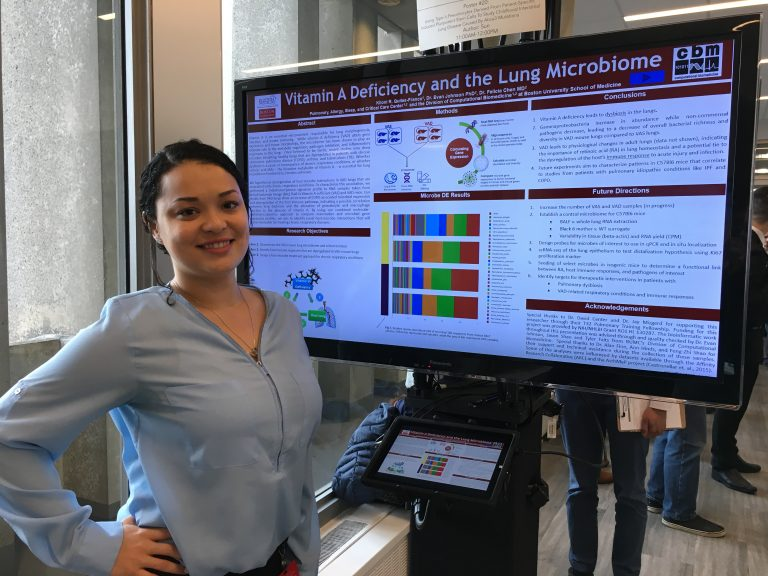 graduate student Kiloni Quiles of the Johnson Lab-Franco presenting a poster at Evans Day