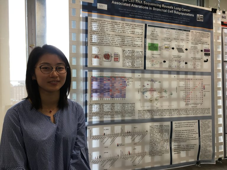 graduate student Xingyi Shi presenting a poster at Evans Day