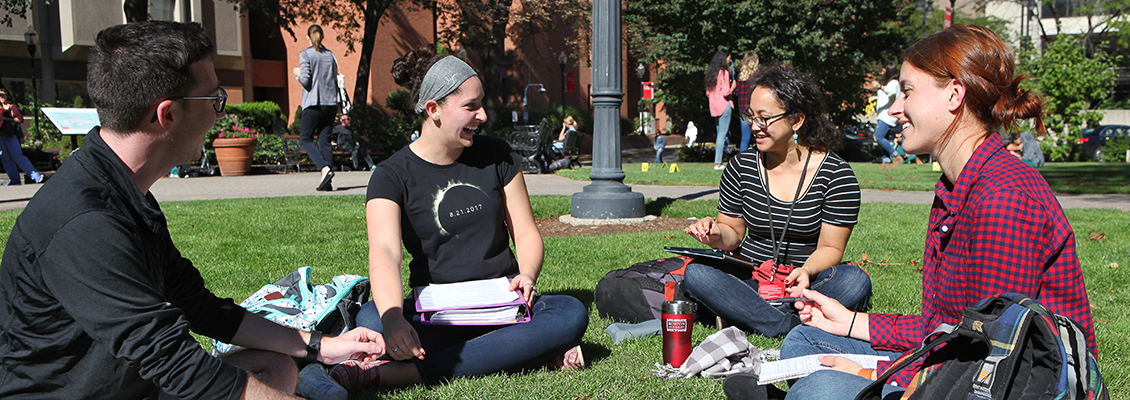 Students studying outside on BU's campus