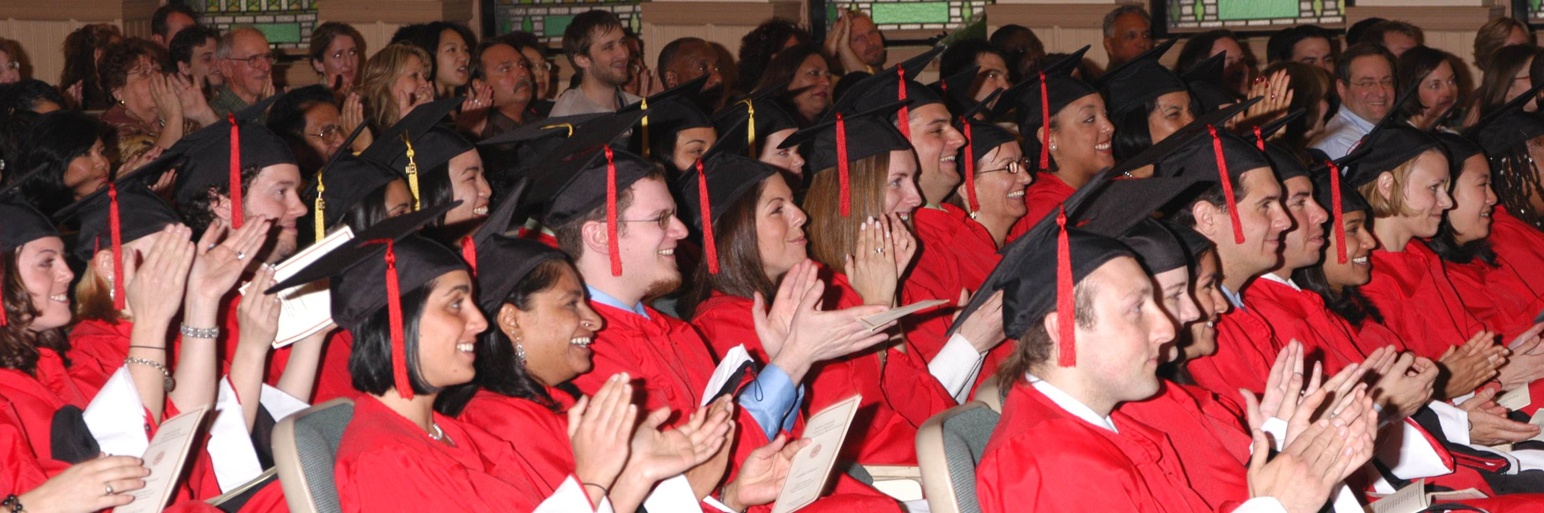 graduating students clapping at ceremony