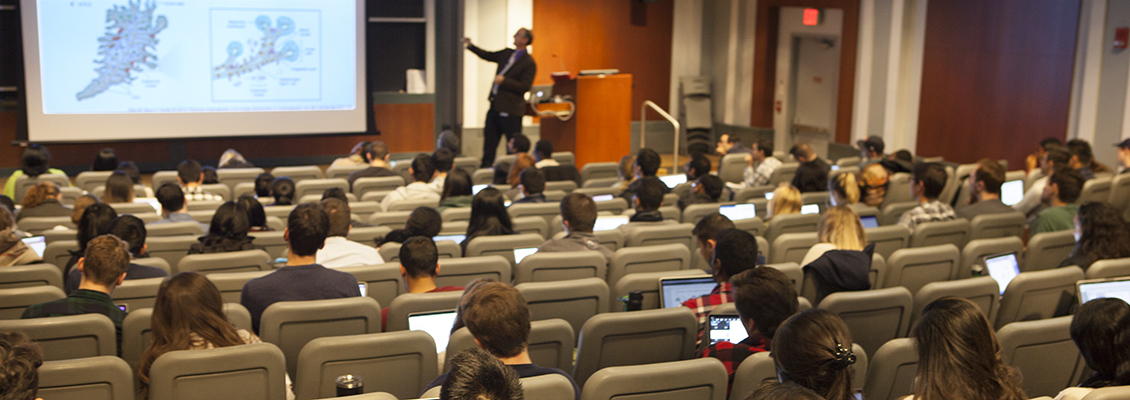 professor teaching in large lecture hall