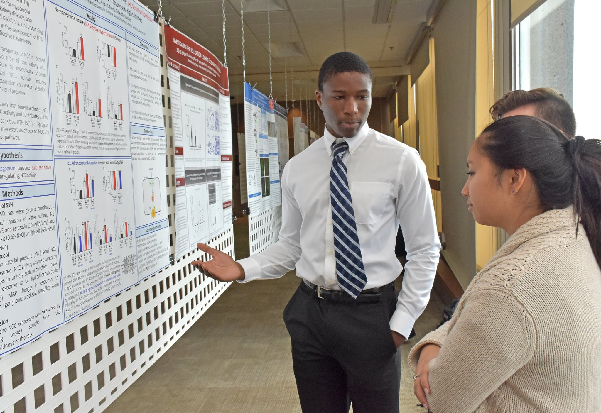 Man sharing his research at poster session