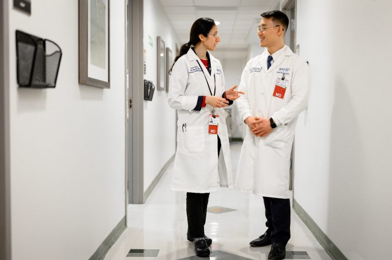Physicians talking in hallway